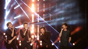 Niall Horan, from left, Liam Payne, Harry Styles and Louis Tomlinson of One Direction perform at the American Music Awards at the Microsoft Theater in Los Angeles on Sunday, Nov. 22, 2015. (Matt Sayles / Invision)