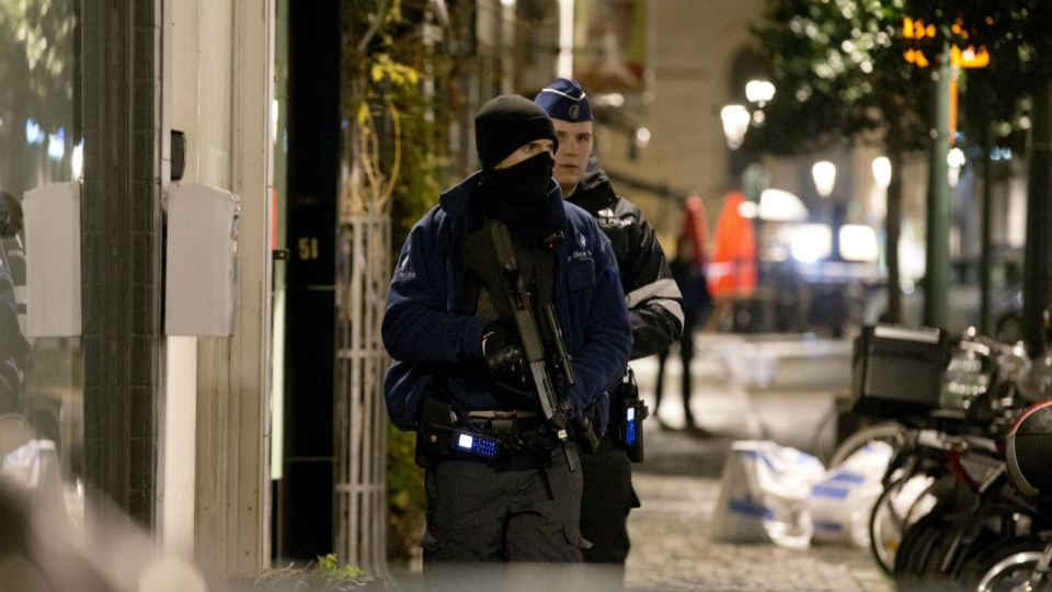Police patrol during an operation in the centre of Brussels on Sunday, Nov. 22, 2015. (AP / Virginia Mayo)