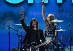 The band Foo Fighters performing at the Time Warner Cable Arena in Charlotte, North Carolina.  (©AFP PHOTO /Stan HONDA)