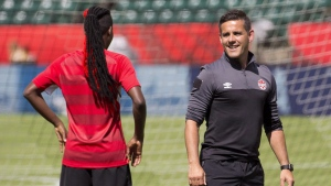 Canada's head coach John Herdman and Kadeisha Buchanan chat during a practice session in Edmonton, Alta., on June 5, 2015. (THE CANADIAN PRESS/Jason Franson)