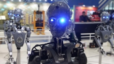 Industrial robots 'dance' at a booth the day before the 2015 China International Industry Fair at National Exhibition and Convention Center in Shanghai, China on Nov. 2, 2015. (ChinaFotoPress)