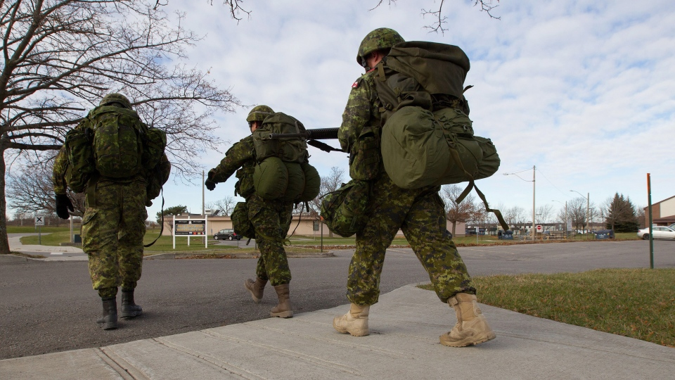 Canadian troops march at CFB Kingston in Kingston, Ont., on Monday Nov. 23, 2015. (Lars Hagberg / THE CANADIAN PRESS)