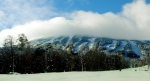 In a photo provided by Sugarloaf USA, skiers enjoy the snow at Sugarloaf mountain in Carrabassett Valley, Maine. (AP /Sugarloaf USA)