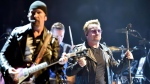 In this Sept. 4, 2015, file photo, Bono, right, leader of Irish rock band U2, performs in Turin, Italy.  (Alessandro Di Marco/ANSA via AP, File)