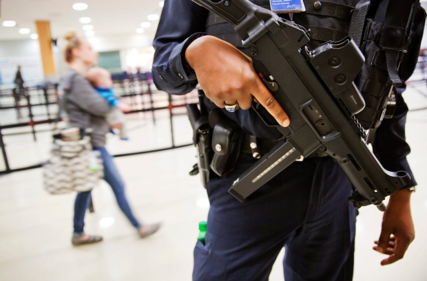 A police officer stands guard by a security checkpoint at Hartsfield-Jackson Atlanta International Airport, Wednesday, Nov. 18, 2015, in Atlanta. (AP / David Goldman)