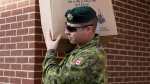 Sgt. Matt MacIsaac removes some of his belongings from storage at CFB Kingston in Kingston, Ont., on Monday Nov. 23, 2015. Several barracks on the base may be used to house Syrian refugees. (Lars Hagberg / THE CANADIAN PRESS)
