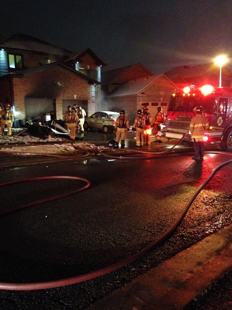 Fire crews battle a fire on Oakcrossing Rd. on Monday, November 23, 2015 in London, Ont. (Celine Moreau / CTV London)