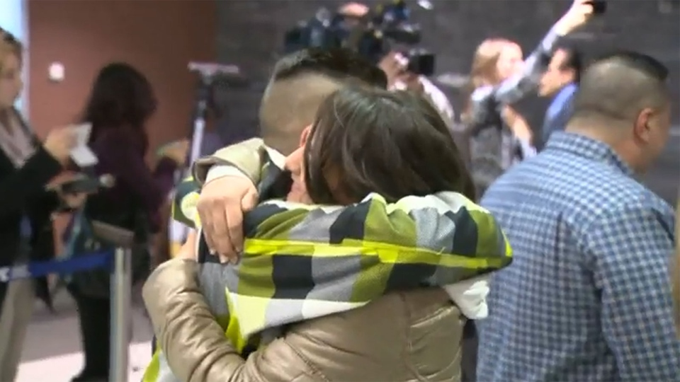 Calgary residents welcome Syrian refugees at the airport.