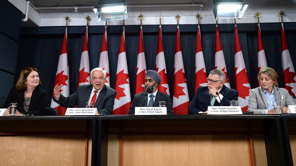 Jane Philpott, (left to right) Minister of Health, John McCallum, Minister of Immigration, Refugees and Citizenship, Harjit Sajjan, Minister of National Defence, Ralph Goodale, Minister of Public Safety and Emergency Preparedness, and Mélanie Joly, Minister of Canadian Heritage announce Canada's plan to resettle 25,000 Syrian refugees, during a press conference at the National Press Theatre in Ottawa on Tuesday, Nov. 24, 2015. (Sean Kilpatrick / THE CANADIAN PRESS)