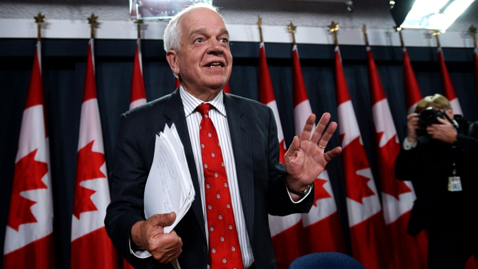John McCallum, Minister of Immigration, Refugees and Citizenship, continues to asked questions as he leaves following an announcement of Canada's plan to resettle 25,000 Syrian refugees during a press conference at the National Press Theatre in Ottawa on Tuesday, Nov. 24, 2015. (Fred Chartrand / THE CANADIAN PRESS)