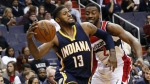Indiana Pacers forward Paul George passes the ball with Washington Wizards guard John Wall behind, during the second half of an NBA basketball game in Washington on Tuesday, Nov. 24, 2015. (AP / Alex Brandon)