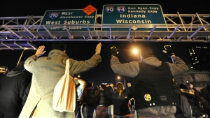 Protesters gesture near Chicago police while trying to enter an expressway in Chicago on Tuesday, Nov. 24, 2015. (AP / Paul Beaty)