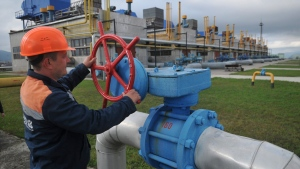 In this Wednesday, Oct. 7, 2015 file photo, a worker at a Ukrainian gas station Volovets in western Ukraine controls a valve. (AP Photo/Pavlo Palamarchuk)