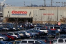 Cars fill the parking lot of a Costco store, Tuesday, Nov. 24, 2015, in Seattle.  (AP/Ted S. Warren)