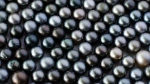 Black pearls are seen in this undated photo. (ChameleonsEye / shutterstock.com)