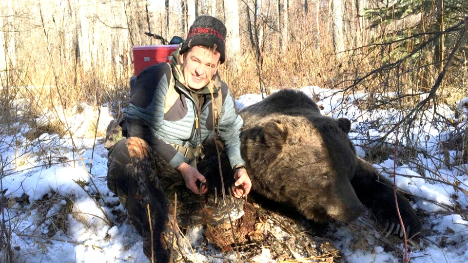 Rick Hollingworth fought off a massive grizzly bear that charged him and his cousin while they were hunting for elk.