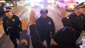 Chicago police form a line to prevent protesters from entering an expressway on Tuesday, Nov. 24, 2015, in Chicago.  (AP / Paul Beaty)