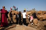 In this file photo, church leaders visit the scene where miners were shot and killed at the Lonmin mine near Rustenburg, South Africa, Monday, Aug. 20, 2012. (AP/Themba Hadebe)