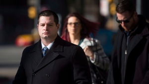 Const. James Forcillo, charged in the shooting death of Sammy Yatim, walks into court in Toronto, Wednesday, Nov, 25, 2015. THE CANADIAN PRESS/Marta Iwanek