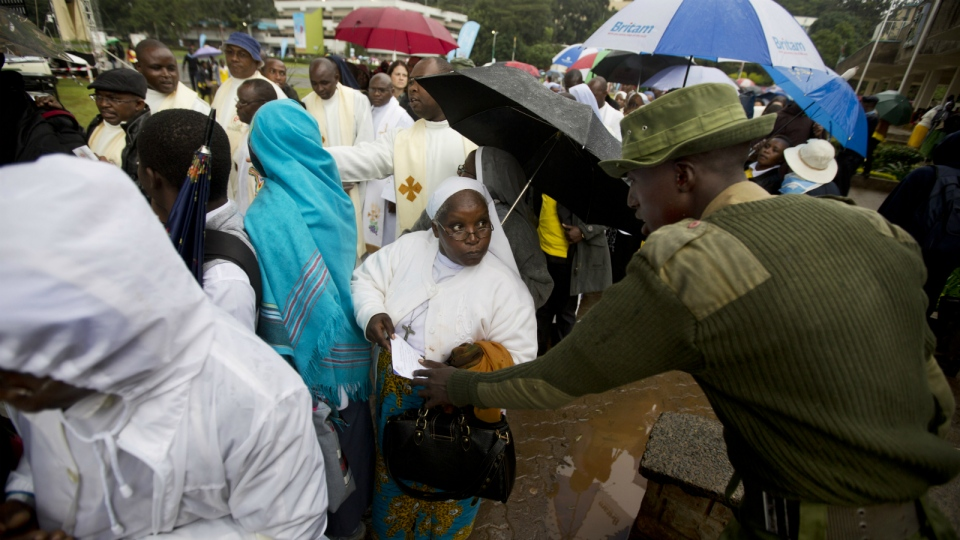 A Kenyan soldier inspects the ticket of a Catholic sister as she queues after dawn to attend a Holy Mass to be given by Pope Francis at the campus of the University of Nairobi in Kenya Thursday, Nov. 26, 2015. (AP / Ben Curtis)