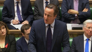 """British Prime Minister, David Cameron addresses lawmakers in the House of Commons, London, making his case for airstrikes as part of a """"comprehensive overall strategy"""" to destroy IS and end the Syrian war, Thursday, Nov. 26, 2015. (Parliamentary Recording Unit)"""