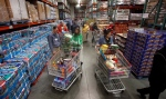 In this Dec. 7, 2011, file photo, customers shop at a Costco, in Portland, Ore. (AP/Rick Bowmer, File)