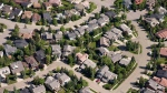 Aerial views of housing in Calgary on June, 22, 2013. (Jonathan Hayward/The Canadian Press)