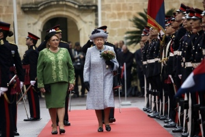 Britain Queen Elizabeth II is flanked by President of Malta, Marie-Louise Coleiro Preca as they review the honor guard during the official welcome ceremony at St. Anton presidential palace in Valletta, Malta, Thursday, Nov. 26, 2015. (AP / Alessandra Tarantino)