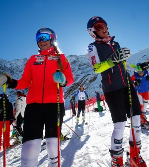 Lindsey Vonn, of the United States, left, and teammate Mikaela Shiffrin stand at the finish area at the Rettenbach glacier, ahead of Saturday's women's giant slalom Ski World Cup race in Soelden, Austria, Friday, Oct. 23, 2015. (AP / Giovanni Auletta)