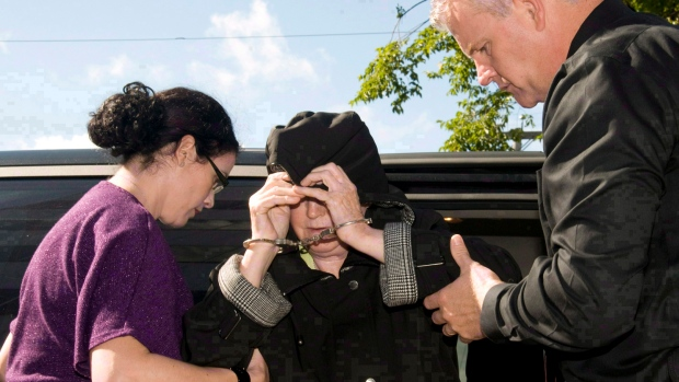 Melissa Ann Shepard heads to court on Tuesday, Oct.2, 2012. (THE CANADIAN PRESS/ Vaughan Merchant)