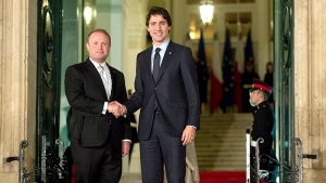 Canadian Prime Minister Justin Trudeau is greeted by Malta's Prime Minister Joseph Muscat as he arrives at the Auberge de Castille ahead of the Commonwealths Heads of Government meeting, Thursday Nov.26, 2015 in Valletta, Malta. (THE CANADIAN PRESS / Adrian Wyld)