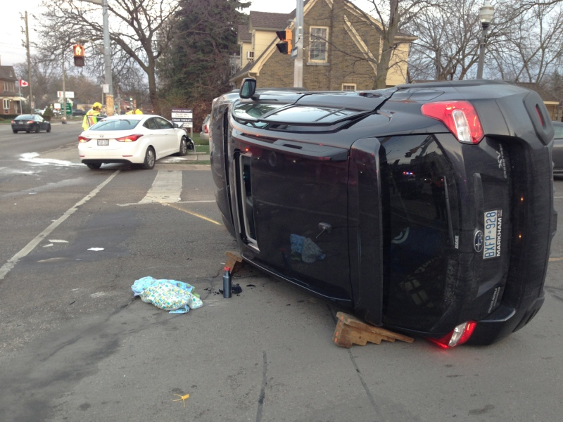 An SUV rests on its side following a collision at Erb and Regina streets in Waterloo on Thursday, Nov. 26, 2015. (Dan Lauckner / CTV Kitchener)