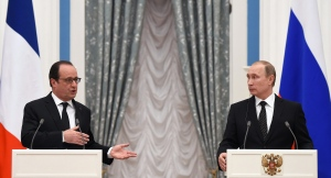 Russian President Vladimir Putin, right, and France's President Francois Hollande, give a joint press conference after their meeting in Moscow, Russia, Thursday, Nov. 26, 2015. (Stephane de Sakutin/Pool Photo via AP)
