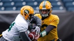 Edmonton Eskimos quarterback Mike Reilly, right, passes the ball to Akeem Shavers during a team practice session in Winnipeg on Wednesday, Nov. 25, 2015. The Eskimos will play the Ottawa Redblacks in the 103rd Grey Cup Sunday. (THE CANADIAN PRESS/John Woods)
