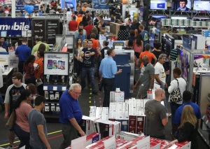 People look at merchandise while holiday shopping at Best Buy in Panama City, Fla. on Thursday, Nov. 26, 2015. (Patti Blake / News Herald via AP)
