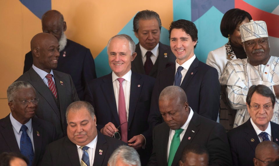 Canadian Prime Minister Justin Trudeau speaks with Australian Prime Minister Malcolm Turnbull and Trinidad and Tobago Prime Minister Keith Rowley as they wait for a group photo to be taken at the Commonwealths Heads of Government meeting, Friday Nov. 27, 2015 in Valletta, Malta. (THE CANADIAN PRESS  / Adrian Wyld)