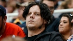 Recording artist Jack White watches the Toronto Maple Leafs-Detroit Red Wings NHL hockey game in Detroit, Friday, Oct. 9, 2015. (AP / Paul Sancya)