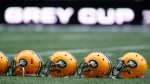 Helmets belonging to members of the Edmonton Eskimos sit on the field during a team practice in Winnipeg, Man. Wednesday, Nov.,25, 2015. (THE CANADIAN PRESS/John Woods)