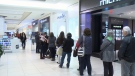 Shopper line up outside a store at Bayshore Shopping Centre in Ottawa, Nov. 27, 2015