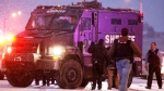 A police vehicle carries a suspect away from the intersection of Centennial and Fillmore after a shooting at a Planned Parenthood clinic in Colorado Springs, Colo. Friday, Nov. 27, 2015. (AP / David Zalubowski)