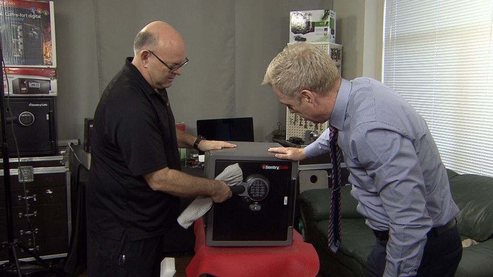 Ross and Mr. Locksmith look at a safe