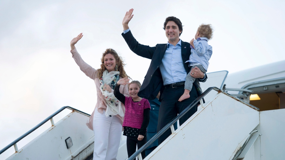 Canadian Prime Minister Justin Trudeau, Hadrien, Ella-Grace and his wife Sophie Gregoire-Trudeau board a government plane as they leave CHOGM Saturday, November 28, 2015 in Valletta, Malta. Trudeau is heading to Paris for the United Nations climate change summit. (Adrian Wyld / THE CANADIAN PRESS)