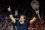 Britain's Andy Murray celebrates winning the doubles Davis Cup final tennis match with his brother Jamie in four sets, 4-6, 6-4, 6-3, 6-2, against Belgium's Steve Darcis and David Goffin at the Flanders Expo in Ghent, Belgium on Nov. 28, 2015. (Alastair Grant / AP Photo)