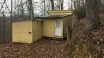 A small shack with no electricity or running water where where Planned Parenthood clinic shooting suspect Robert Lewis Dear spent time, is shown Saturday, Nov. 28, 2015, about a half-mile up a twisty dirt road near Black Mountain, N.C. (AP / Michael Biesecker )
