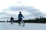 Many Syrian migrants are braving a frigid trek by bicycle from Russian to Norway in search a of better life.