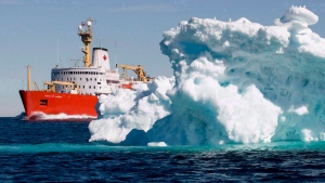 The Canadian Coast Guard icebreaker Louis S. St-Laurent sails past a iceberg in Lancaster Sound, Friday, July 11, 2008. (Jonathan Hayward/The Canadian Press)