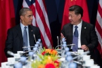 U.S. President Barack Obama, left, meets with Chinese President Xi Jinping during their meeting held on the sidelines of the COP21, United Nations Climate Change Conference, in Le Bourget, outside Paris, Monday, Nov. 30, 2015. (AP / Evan Vucci)