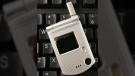 A C3 flip phone from Pantech is shown, on a keyboard for size comparison, in New York, Thursday, March 8, 2007. (AP / Mark Lennihan)