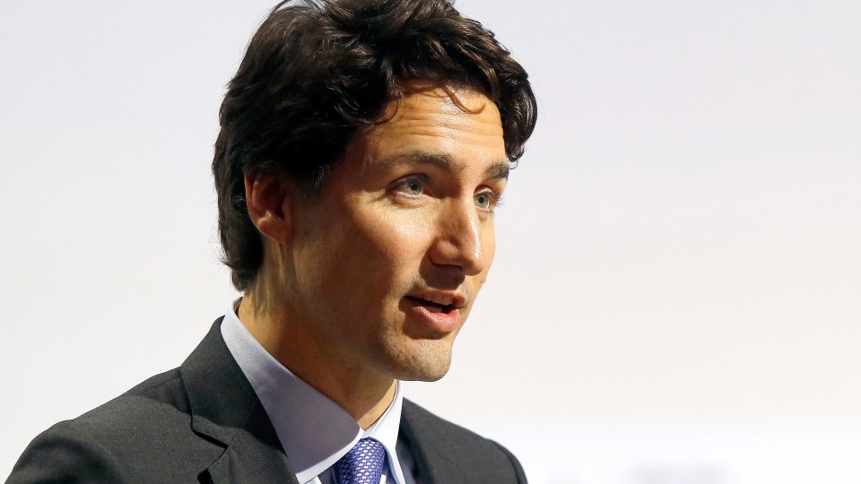 Canadian Prime Minister Justin Trudeau addresses world leaders at the COP21, United Nations Climate Change Conference, in Le Bourget, outside Paris, Monday, Nov. 30, 2015. (AP / Michel Euler)