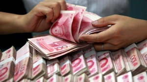 In this Friday, June 8, 2012 photo, a clerk counts Chinese banknotes at a bank in Huaibei in central China's Anhui province. (Chinatopix via AP, File)